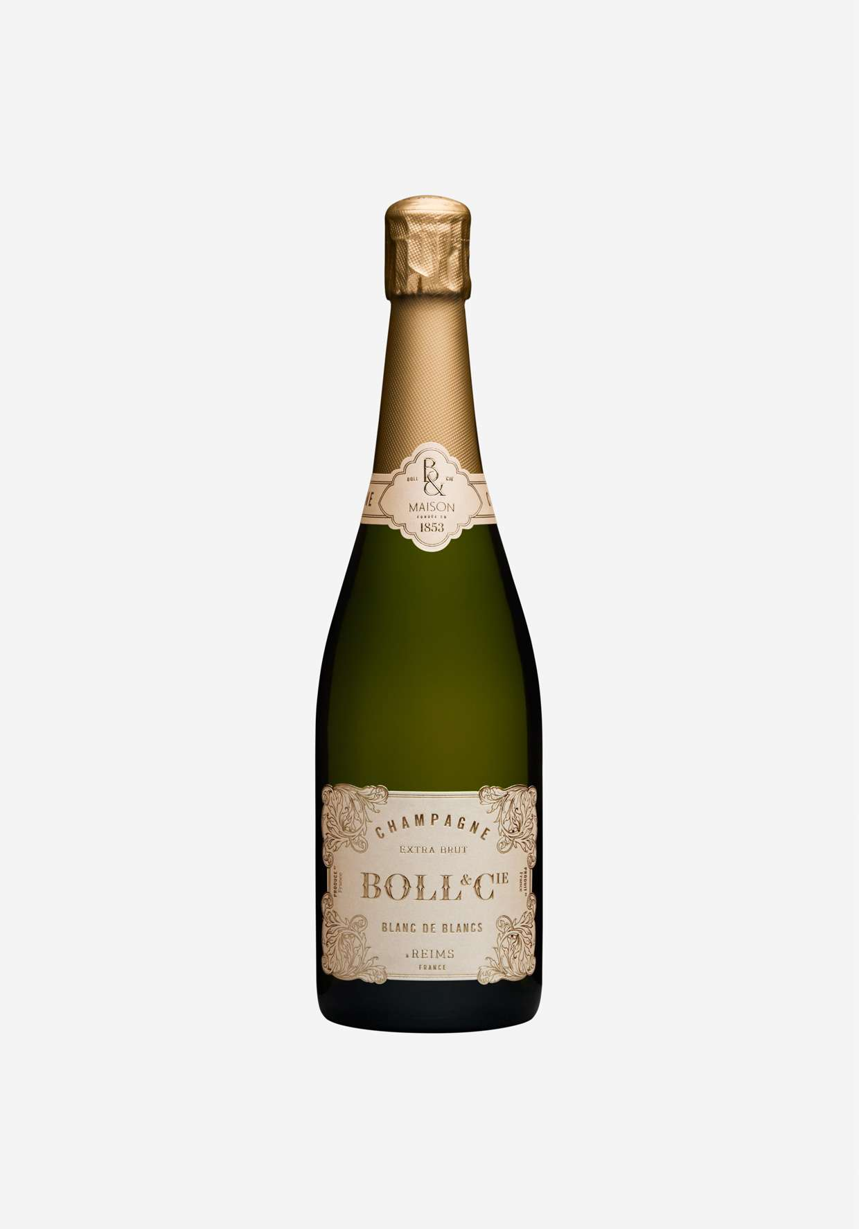 A close-up of a bottle of Extra Brut Champagne from Boll and Cie