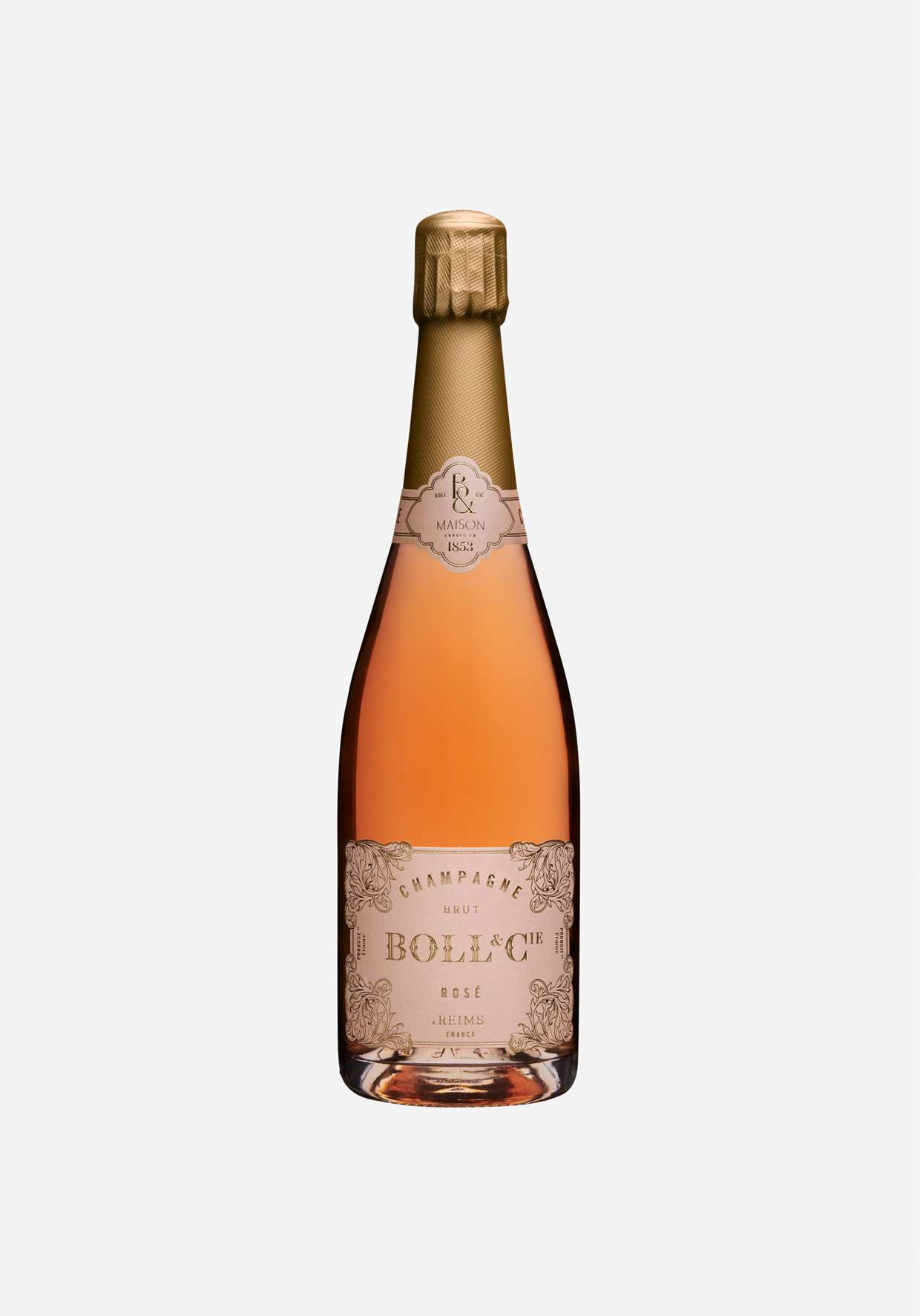 A close-up of a bottle of Rose Champagne from Boll and Cie